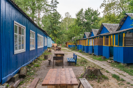 bungalow: many blue bungalow in a ukrainian camo in the forest