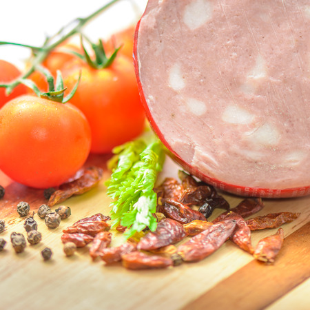 Italian Mortadella Bologna with tomatoes and vegetables Stock Photo