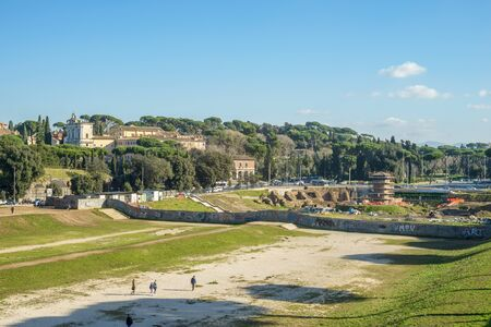 massimo: Rome, Italy - January 04, 2015: People walking in the arena called Circo Massimo in Rome where in ancient age was the horses race Stock Photo