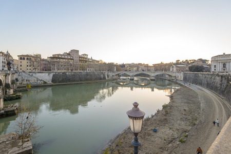 tevere: Rome, Italy, - January 04, 2015: Peoplewalking along the tevere river in rome near vatican