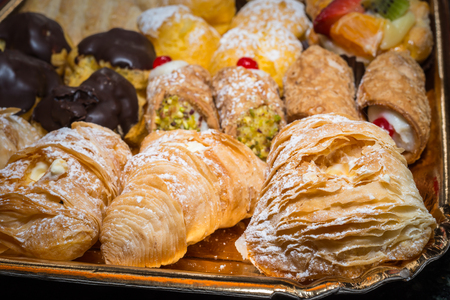 colorful pastries with fruits, cream and chocolate, the real Italian confectionery Banco de Imagens