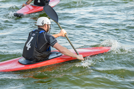 combines: Rome, Italy - March 28, 2015: men playing kayak polo. Kayak polo combines canoeing and ball handling skills with an exciting contact team game, where tactics and positional play are as important as the speed and fitness of the individual athletes.