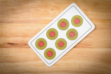 jack of diamonds: Seven, settebello italian card on a wood background