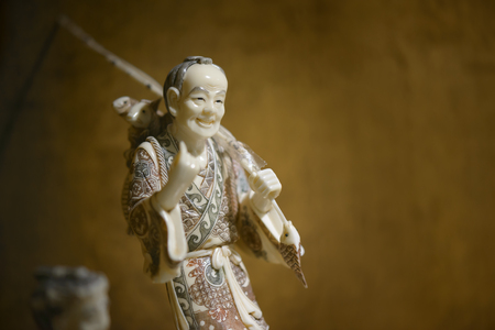 imperialism: Rome, Italy - August 02, 2015: ivory chinese statuette, requisitioned to smugglers of ivory
