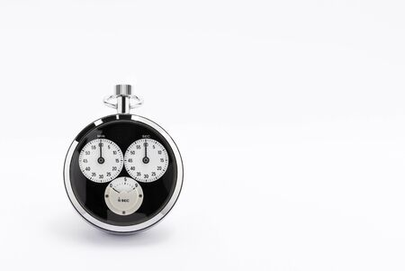 An old black and chrome chronometer perfectly working on a white background Stock Photo