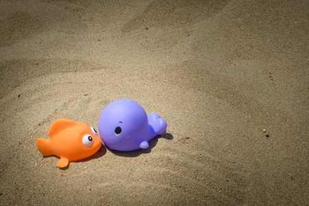 plastic toys: funny and colorful plastic toys on the beach Stock Photo