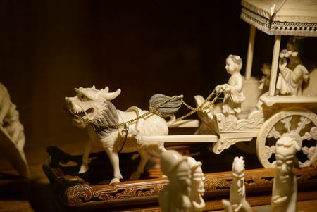 imperialism: Rome, Italy - August 08, 2015:  A Chinese ivory statuette, requisitioned by the Italian financial police to some ivory traffickers at the airport Leonardo da Vinci of Rome