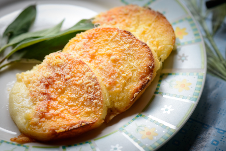 Gnocchi alla romana, typical Italian recipe made with semolina and cheese