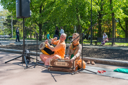 Kharkiv, Ukraine - May 03, 2014:�hare krishna couple sing and play in a Kharkiv square