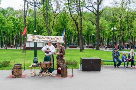 Kharkiv, Ukraine - May 01, 2014: traditional ukrainian musician couple playing in a public park in kharkiv Editorial