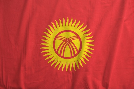 Fabric texture of the flag of Kyrgyzstan photo