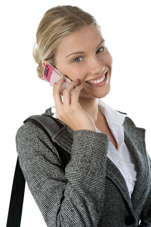 Attractive young business woman talking on a mobile phone against white Stock Photo - 6012861