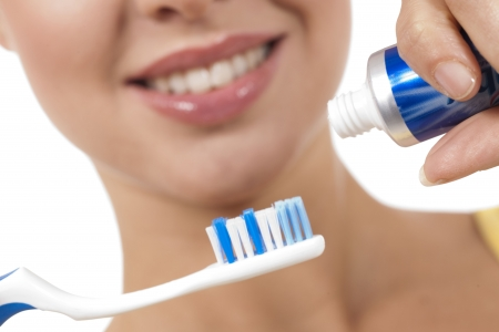 A close up of a beautiful woman with toothbrush, foucs on the object photo