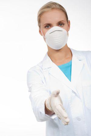 若い女性医師は保護マスクとラテックスの手袋