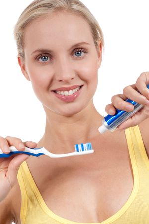 Smiling young woman with toothbrush, isolated on white photo