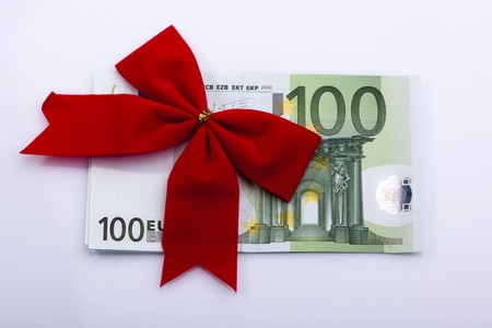 one hundred euro banknote: Red ribbon on one hundred Euro banknote, isolated on white Stock Photo