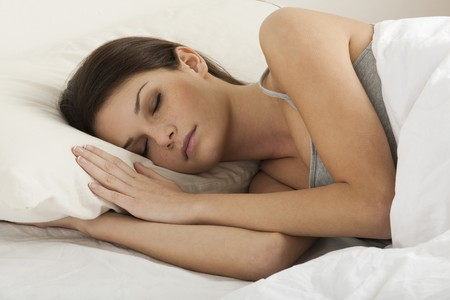 Beautiful young woman sleeping photo