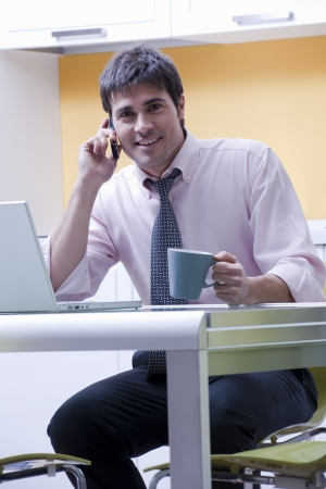 Young businessman at home photo