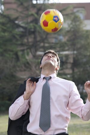 Businessman playing soccerfootball photo