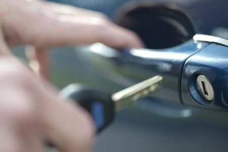 Opening door of a luxury car photo