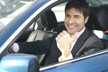 Smiling driver with thumb up