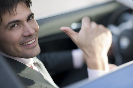 Smiling driver with thumb up photo