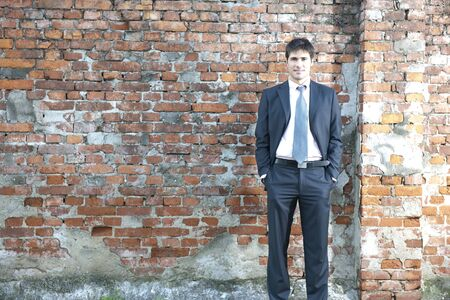 roughness: Businessman standing outside. Concept: Contrast beteween elegance and roughness Stock Photo