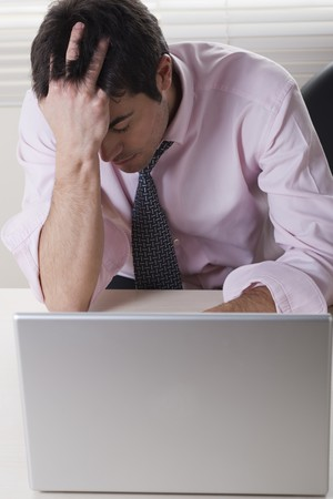 Exhausted businessman on his desk Stock Photo - 7317092