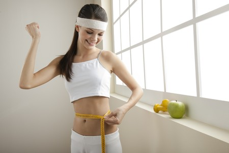 Young woman looking excited for her successful diet photo