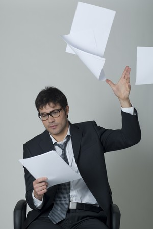 Businessman throwing documents away! photo