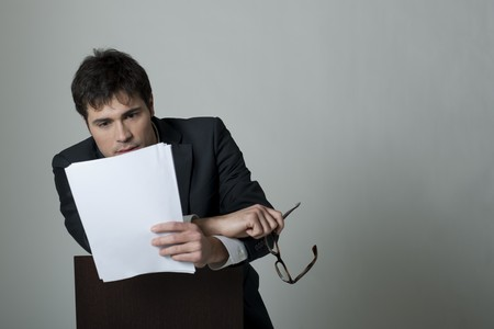Businessman reading document Stock Photo - 7355742