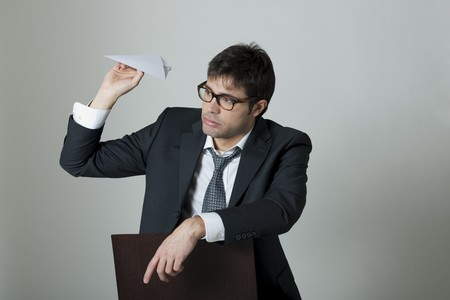 Businessman with paper plane photo