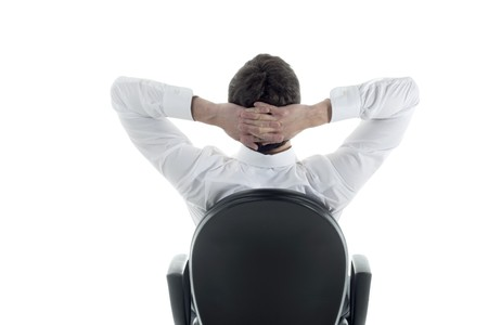 Rear viwe of a relaxed businessman with hands behind his head Stock Photo - 7355694