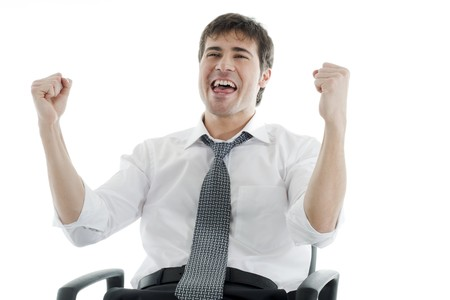 Successful businessman with fists raised photo