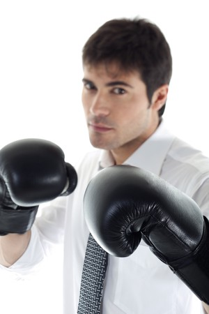 aggressiveness: Businessman with boxing gloves. Concept: competition, aggressiveness. Focus on the gloves. Stock Photo