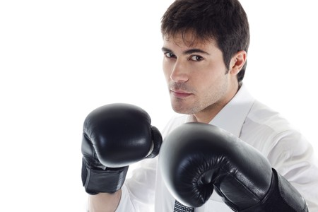 Businessman with boxing gloves. Concept: competition, aggressiveness. photo