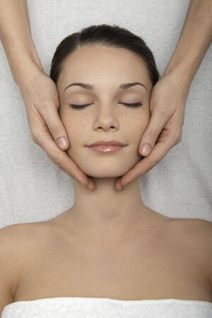 Young woman receiving head massage Stock Photo - 7355892