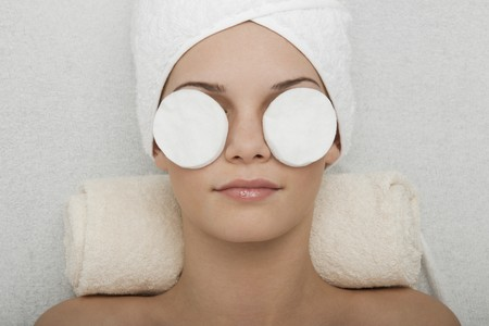 Young woman receiving face cleansing at beauty spa Stock Photo - 7355873