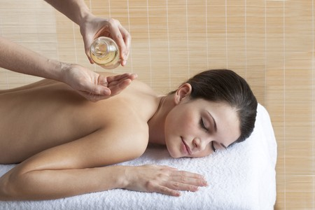 oil massage: Beautiful relaxed woman receiving back massage with oil