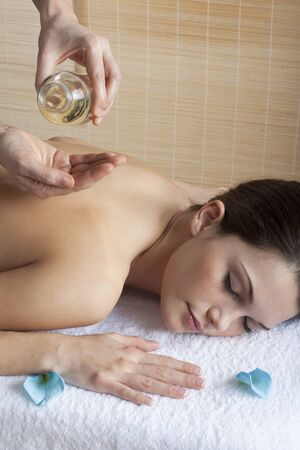 Beautiful relaxed woman receiving back massage with oil Stock Photo - 7355918