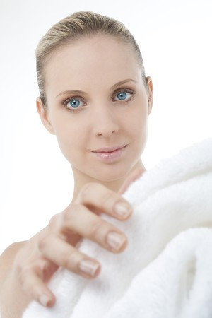 Beautiful woman wearing bathrobe, focus on the model photo