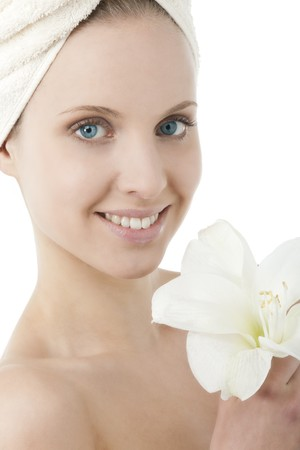 Beauty wrapped in towel holding a flower photo