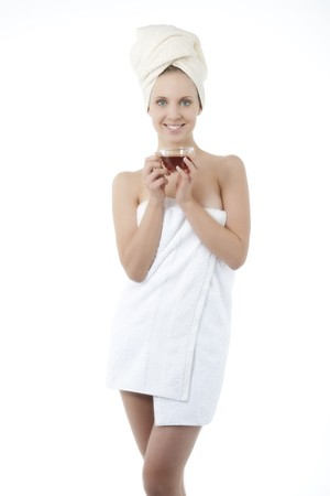 Beauty wrapped in towel with herbal tea Stock Photo - 7368720