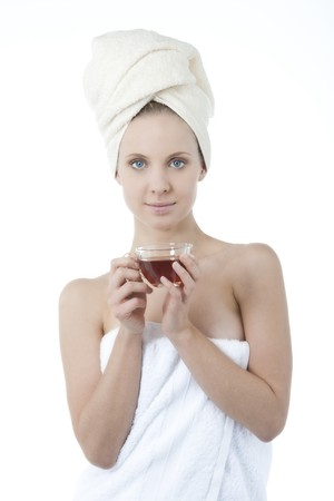 Beauty wrapped in towel with herbal tea Stock Photo - 7368740