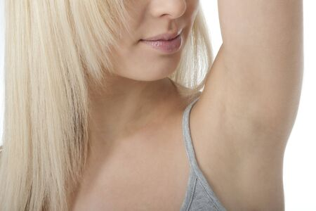 Portrait of pretty woman looking her clean fresh armpit Stock Photo - 7368845