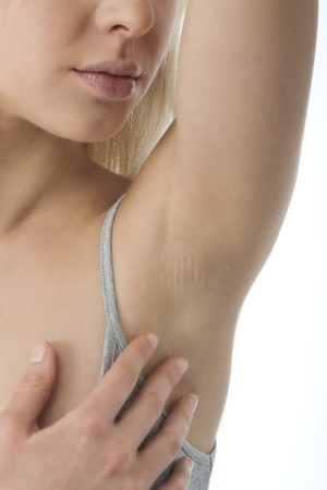 adult armpit: Portrait of pretty woman looking her clean armpit