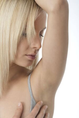 armpit hair: Portrait of pretty woman looking her clean armpit