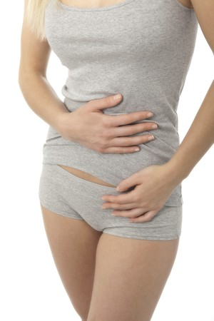 the diarrhea: Mujer Contornear su vientre; bellyache o estre�imiento  Foto de archivo