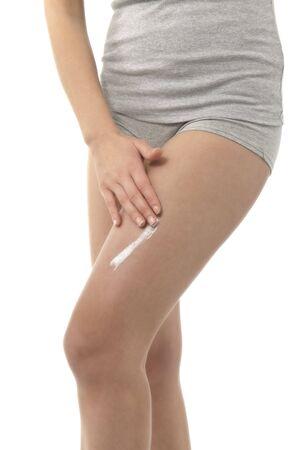 Woman applying moisturizer Stock Photo - 7368833