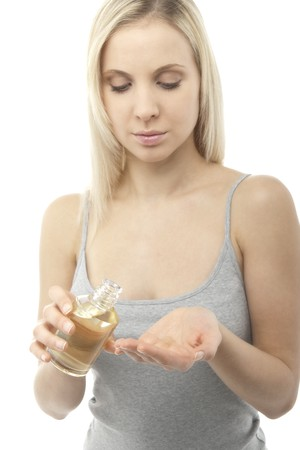 Young woman applying spa oil on her palm Stock Photo - 7368769